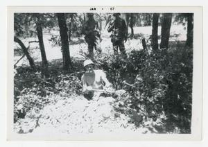 Primary view of object titled '[Photograph of Sergeant Stan Folkman Digging Hole]'.