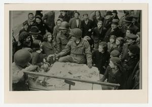 Primary view of object titled '[GI Surrounded by French Civilians]'.