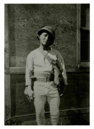 Primary view of object titled '[Photograph of Soldier Outside Building]'.