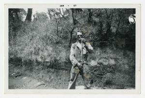 Primary view of object titled '[Photograph of Sergeant Stan Folkman Holding a Snake]'.
