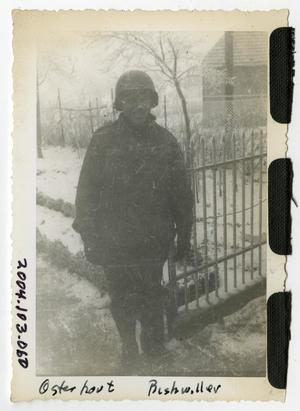 Primary view of object titled '[Photograph of Soldier in Snowy Garden]'.