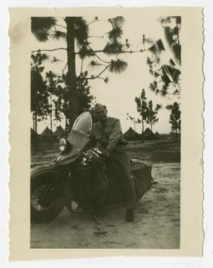 Primary view of object titled '[Photograph of Soldier on Motorcycle]'.