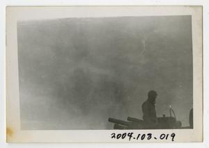 Primary view of object titled '[Photograph of Soldier on Armored Artillery Gun]'.