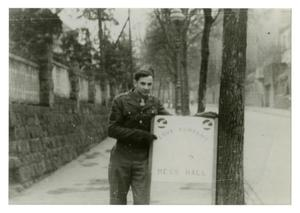 Primary view of object titled '[Photograph of Soldier with Sign]'.