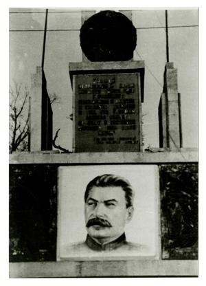 Primary view of object titled '[Photograph of Stalin Portrait on Wall]'.