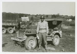 Primary view of object titled '[Photograph of Soldier and Jeep]'.
