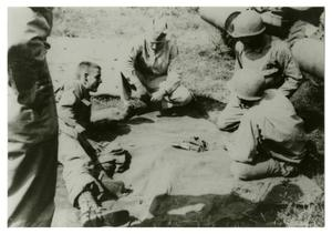 Primary view of object titled '[Photograph of Soldiers on Tarp]'.
