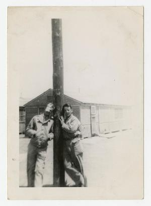 Primary view of object titled '[Photograph of Soldiers and Telephone Pole]'.