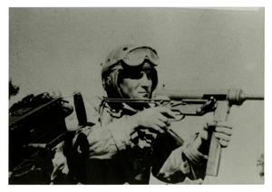 Primary view of object titled '[Photograph of Soldier Aiming Gun]'.