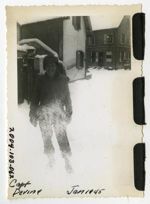 Primary view of object titled '[Photograph of Captain Devine in Snowy Street]'.