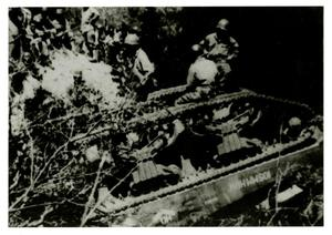 Primary view of object titled '[Photograph of Soldiers on Overturned Tank]'.