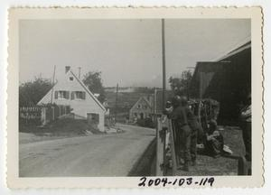 Primary view of object titled '[Photograph of Soldiers Outside German Town]'.