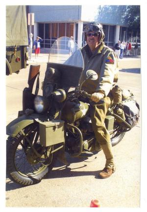 Primary view of object titled '[World War II Motorcycle in Parade]'.