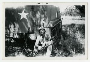 Primary view of object titled '[Photograph of Sergeant Stan Folkman and Half-Track]'.
