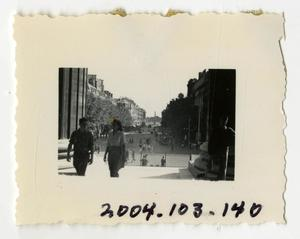 Primary view of object titled '[Photograph of Man and Woman on Steps of Building]'.