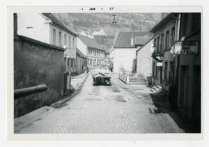 Primary view of object titled '[Photograph of Truck on City Street]'.