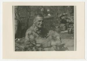 Primary view of object titled '[Photograph of Clyde Maddox in Camp]'.