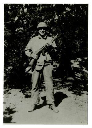 Primary view of object titled '[Photograph of Soldier with Rifle]'.