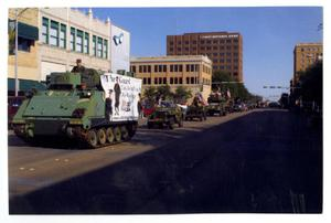 Primary view of object titled '[Tank and Jeeps in Dedication Parade]'.