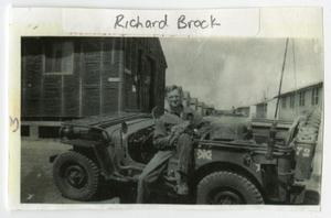 Primary view of object titled '[Richard Brock in a Jeep]'.