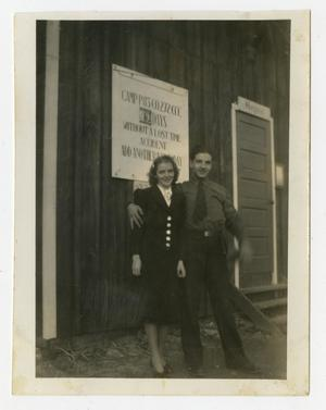 Primary view of object titled '[Photograph of Soldier and Woman Outside Hospital]'.