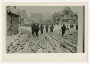 Primary view of object titled '[Photograph of Soldiers in Snowy Street]'.