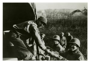 Primary view of object titled '[Photograph of Soldiers Recieving Food]'.