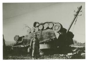 Primary view of object titled '[Photograph of Soldier and Overturned Tank]'.