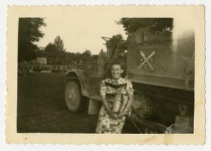 Primary view of object titled '[Photograph of Girl and Army Truck]'.