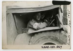 Primary view of object titled '[Photograph of Soldiers in Medical Vehicle]'.
