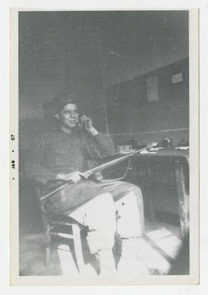 Primary view of object titled '[Photograph of Soldier Using German Radio]'.