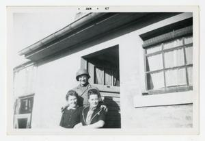 Primary view of object titled '[Photograph of Stan Folkman and Women]'.