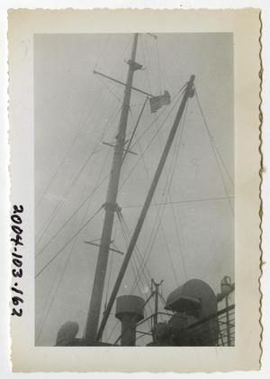 Primary view of object titled '[Photograph of American Flag on Ship's Mast]'.