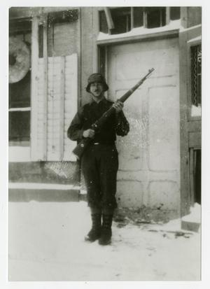 Primary view of object titled '[Photograph of Soldier Standing Guard]'.