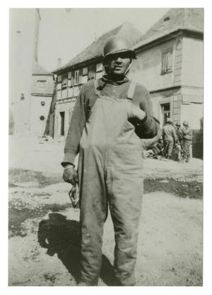 Primary view of object titled '[Photograph of Soldier in Overalls]'.