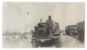 Primary view of object titled '[Soldier Sitting on the Hood of Truck]'.