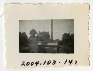 Primary view of object titled '[Photograph of Girl on Ambulance]'.