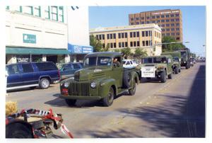 Primary view of object titled '[Trucks in Dedication Parade]'.