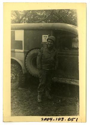 Primary view of object titled '[Photograph of Soldier and Ambulance]'.