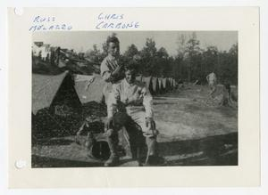 Primary view of object titled '[Photograph of Soldier Giving Haircut in Camp]'.