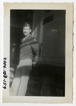 Primary view of object titled '[Photograph of Army Captain on Ship]'.