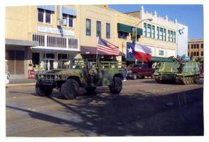 Primary view of object titled '[Tanks and Trucks in Dedication Parade]'.