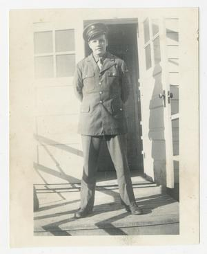 Primary view of object titled '[Photograph of Soldier on Porch]'.