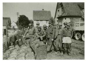 Primary view of object titled '[Photograph of Soldiers and Supplies]'.