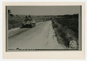 Primary view of object titled '[Photograph of Tanks on Country Road]'.