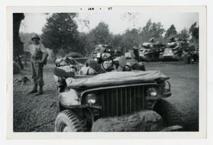 Primary view of object titled '[Photograph of Soldiers Sleeping in Jeep]'.