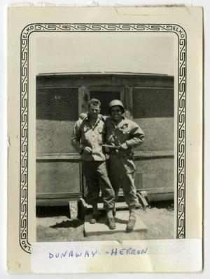 Primary view of object titled '[Photograph of Dunaway and Herron in Front of Barracks]'.