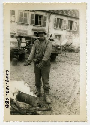 Primary view of object titled '[Photograph of Lieutenant Next to Fire]'.