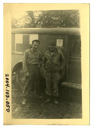 Primary view of object titled '[Photograph of Soldiers and Ambulance]'.