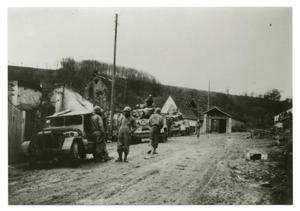 Primary view of object titled '[Photograph of Soldiers and Tanks in Road]'.
